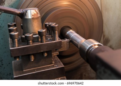 Close up metal machine working on steel factory, bore machining process by cutting/drilling  tool on automated lathe at steel factory,  heavy metal industry