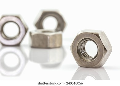 Close up Metal nuts on white background.