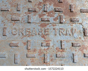 close up of the metal texture of a grease trap