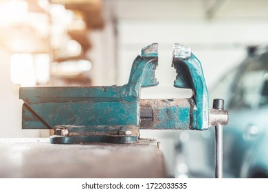 Close up of a metal vice in a garage workshop