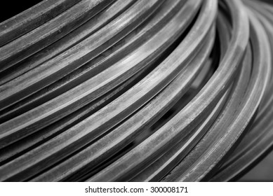 Close up metallic wire coil for industrial background in black and white color