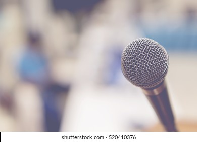 Close up of microphone in concert hall , conference seminar room background,selective focus,vintage color,copy space
