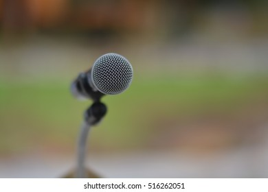 Close up of microphone in concert  outdoor event