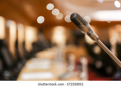 close up of microphone in conference room or in room for background