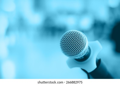 Close up of microphone in conference room on blurred background