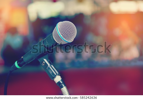 Close up of microphone in conference room on soft focus blur background