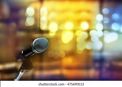 Close up of microphone in focus and back of it out of focus bokeh background at conference room