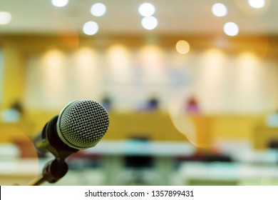 Close up of microphone on a podium in auditorium.Selective focus point.
