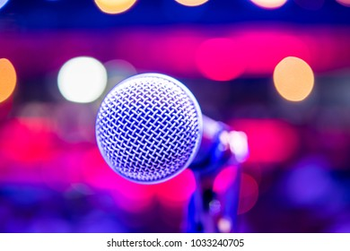 Close up microphone on stage in concert hall