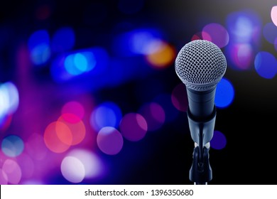 Close up microphone  on stage in concert hall or conference ball room. Let's sing