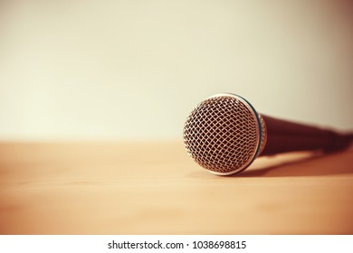 Close up Microphone on the table, concept of speaker or teacher preparation to speak in seminar class room