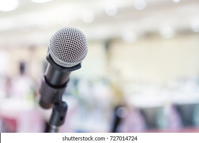 Close up of microphone for voice speaker in party event hall or conference meeting room.