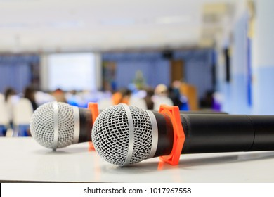 Close up microphone wireless old on the table in the conference and Background blur interior seminar meeting room