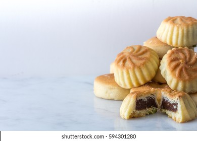 Close Up Middle Eastern Eid Cookies Filled with Dates in a Stack on Light Background Copy Space Horizontal