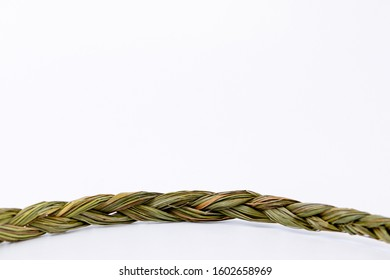 Close up of middle of sweetgrass braid isolated on white background