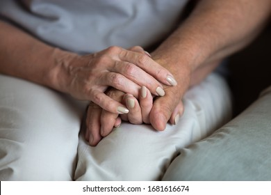 Close up middle-aged wife holding older husband hands, expressing love and empathy, caring adult daughter helping elderly father to overcome problems, caregiver consoling and supporting patient