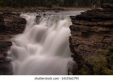 A close up of the mighty Athabasca Waterfall in Banff National Park, Canada, the torrent of water squeezes through a gap in rocks, long exposure to create blurred motion to the waterfall