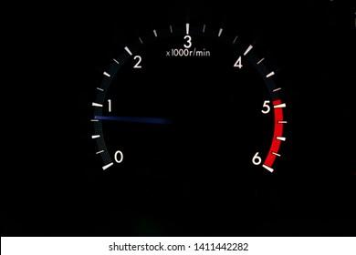 close up mileage screen in car and dark background
