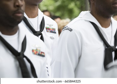 Close up of military medals, ribbons, and neck scarves worn by U.S. Navy personnel at the re-enlistment and promotion ceremony on National September 11 Memorial site. Fleet Week, NEW YORK MAY 26 2017