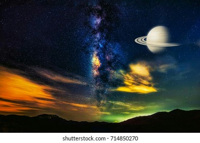 Close up of Milky Way with Saturn seen with the telescope. Clearly Milky Way showing detail of starry sky and beautiful universe on night colorful landscape. Space and Galaxy Isolated background
