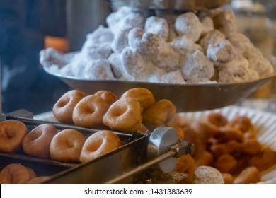 Close up of Mini Donuts on Vintage Frying Machine in public market