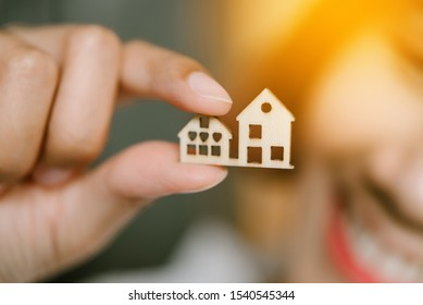 Close up of mini house on woman hand.