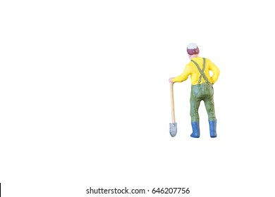 Close up of Miniature farmer people isolated with clipping path on white background
