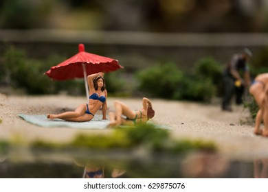 Close up of Miniature world, girls on the beach