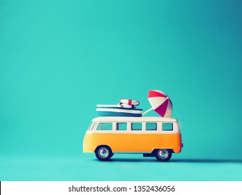 Close up miniature yellow car on blue background with copy space,summer vacation concept.