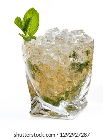 close up of a mint julep served over crushed ice with mint leaves and simple syrup isolated on a white background
