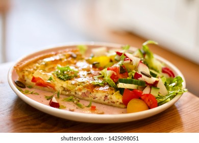 Close up mix salad served with quiche lorraine with morning light