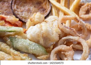 Close up of mix vegetables and calamari fried.