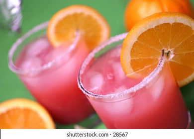 Close up of a mixed drink cocktail with orange wedge
