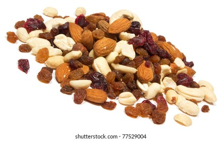 Close up of mixed nuts with raisins in white background.