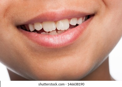 Close up of mixed race boys mouth with nice white teeth.