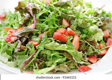 Close up of mixed salad of vegetables and fruits