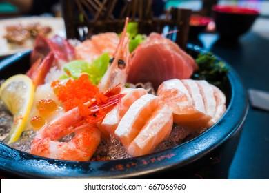 Close up Mixed sashimi, big sashimi plate,Sashimi salmon set, raw fish, japanese food in Asian restuarant .(Selective focus)
