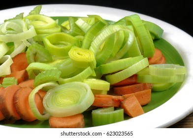 Close up of mixed vegetables to browned in Italian cooking: carrot, celery, leek and onion
