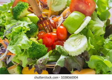Close up Mixed vegetables Salad Eating on Wooden Table.