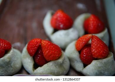 Close up Mochi or daifuku with fresh strawberry, Ichigo Daifuku, Mohi or daifuku a famous Japanese dessert with fresh strawberry.