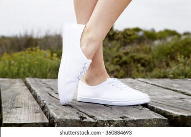 Close up of model in white sneakers