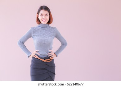 Close up modern business women with space pink background, Business woman standing confident pose, Asian people young beautiful businesswoman smile. casual outfits business concept
