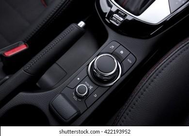 close up of modern car audio entertainment control button