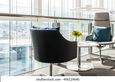 Close up of modern chairs and modern waiting room at office