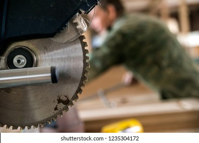 Close up modern circular wood saw in woodworking shop