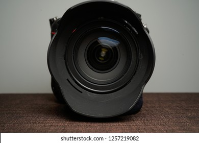 Close up of modern digital camera lense, a view of the front lens with flare effects