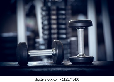 Close up of modern dumbbells equipment in the sport gym , gym equipment concept.