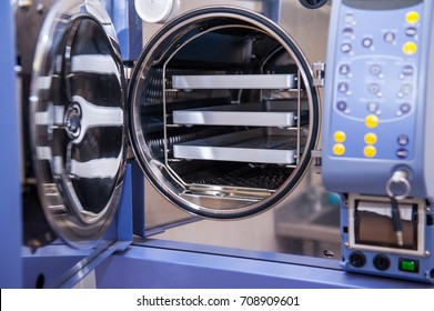 Close up Modern laboratory autoclave sterilizer on the table. Selective focus