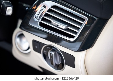 Close up of modern luxury car air vent. Air Conditioner refreshment and smell elimination concept. Background for A/C cleaning and making air conditioning colder.