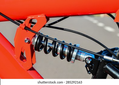 Close up of Modern Red Full Suspension Mountain Bike MTB Bicycle